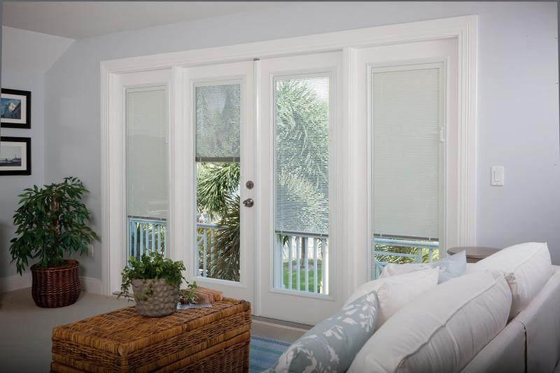 Pros and cons of blinds between glass panes through the front door blinds in patio door glass planetlyrics Images